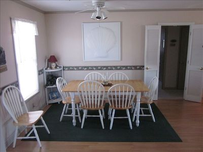 Dining area; additional chairs in bedrooms; 4 stools at bar