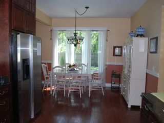 Oconomowoc house photo - Informal eat in kitchen space with seating for at least 6