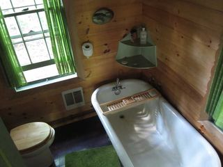 Stanfordville cottage photo - inside bath with large claw footed tub, sink and toilet.