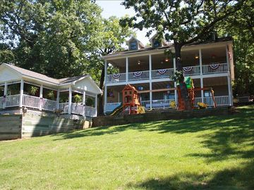 Eureka Springs house rental - A picture looking up from the lake of the house and gazebo.