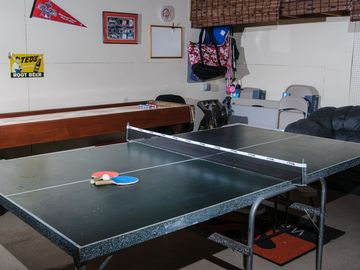 Shuffleboard, darts, and table tennis await you in the garage!