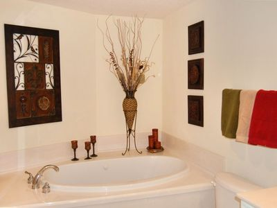 Full bath with jacuzzi tub and walk in shower