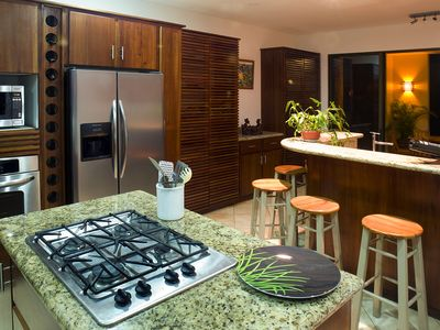 Dominical villa rental - Kitchen and bar, with granite counters, cedar cabinets, mega space!