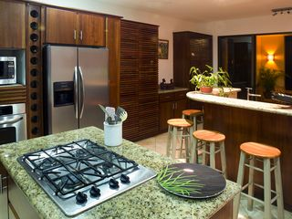 Dominical villa photo - Kitchen and bar, with granite counters, cedar cabinets, mega space!