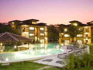 Tamarindo condo photo - Walk in beach pool and BBQ ranch in front of buildings 11, 12, 14, 15 and 16.