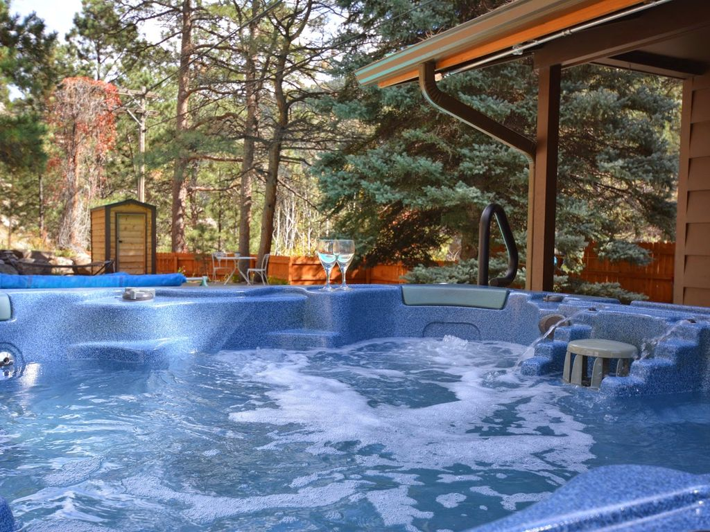 Private cabin on river heated pool 7 man vrbo for Cottages with sauna and hot tub