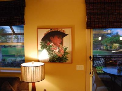 A friendly Paniolo greets you in the living room. The golf course is outside.