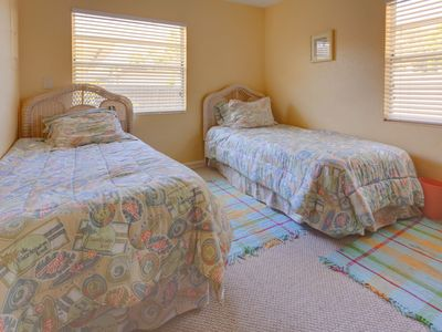 Two twin beds make up the second bedroom at our vacay cottage!