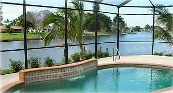 Screened heated pool overlooking the water