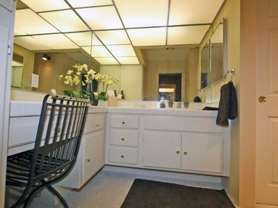 The master bathroom has 'his & her vanities, a tub, and separate shower stall.