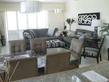 Palm Desert condo rental - Living room, dining room area leading outside to the patio.