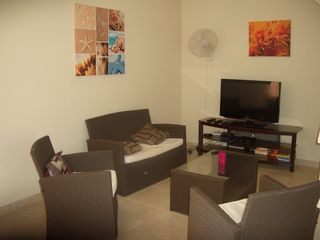 Bonaire condo photo - TV Room with cable, DVD and flat screen TV with HDMI, SD Card and USB input