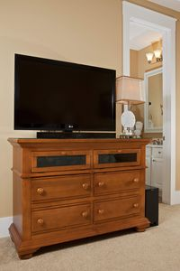 "1st Floor Bedroom TV & Dresser:42"" LG TV, Sound Bar/Sub & Google TV System."