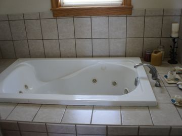 Jacuzzi tub in top floor bedrooom.All bedrooms have private bath.