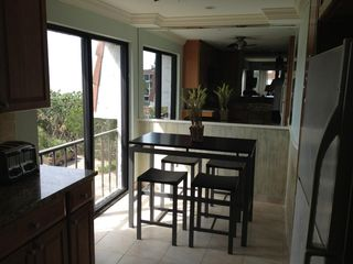 Sanibel Island condo photo - Morning coffee with a view of pool and Gulf of Mexico!