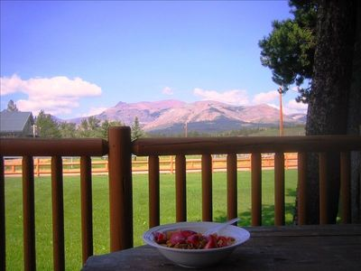View of the Rocky Mountains while having breakfast on the deck