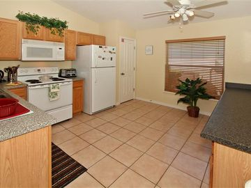 Fully equipped Kitchen with good lighting, and ceiling fan.