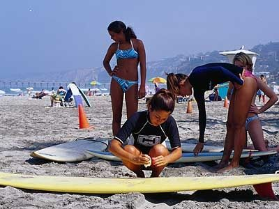 Let the kids take surf lessons at one of the local surf camps while on vacation