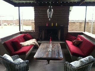 Taos house photo - Cozy Outdoor Lounge with Giant Fireplace and Velvet Upholstered Banquettes