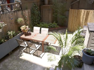 SoHo apartment rental - backyard with table and one leaf open for 6 with 4 chairs