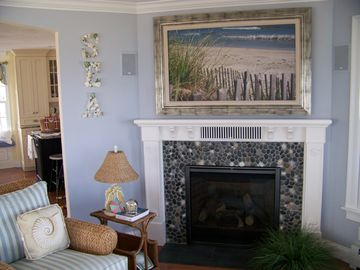 Family Room With Fireplace & 52-inch TV Behind Photo