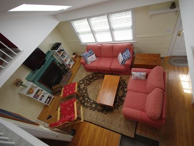 Aerial view of the living room. Teens enjoy watching TV from this loft perch.