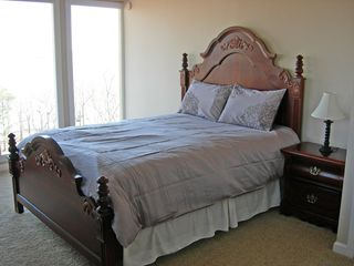 Kentucky Lake house photo - Main level bedroom with comfy king-sized bed, two dressers and walk-in closet.
