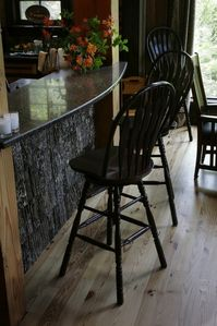 Granite counter main level bar next to kitchen.