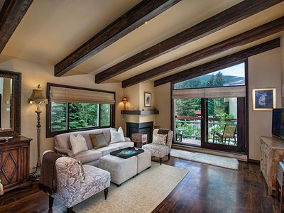 Living room with vaulted ceilings with a lot of windows for natural light