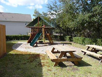 Playground with jungle gym, picnic tables.