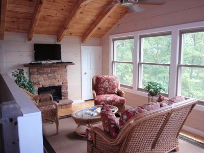 Stone fireplace with flat screen tv, relax comfortably upstairs.