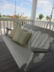 Avalon cottage photo - Front porch swing with view of the bay
