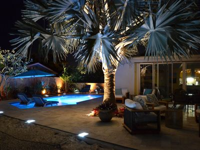 Evening lighting for the patio and pool set the scene for entertaining in style
