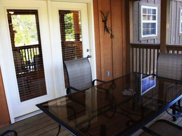 Screened in deck overlooking Fox Hollow Lake.