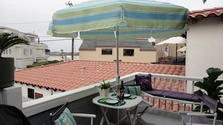 Mission Beach apartment photo - Full sun deck. Above the Crowd view of boardwalk and volleyball activities.