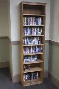 A shelf filled with DVD's available in the hall. Plus we have Dish TV with HBO.