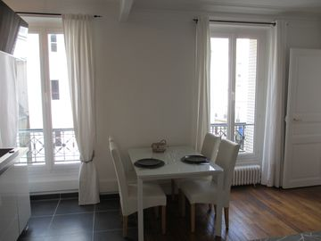 17th Arrondissement Batignolles-Monceau apartment rental - Spacious living room with dining table