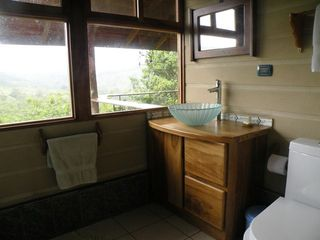 San Ramon villa photo - The master bathroom has a glass bowl sink and spectacular canyon views.