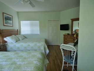 "Port St. Lucie condo photo - ""B"" Side Bedroom with two Queen Beds, Flat Screen TV and DVD player"
