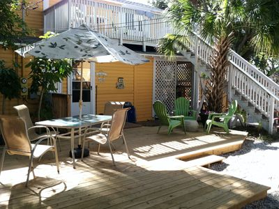 Indian Rocks Beach cottage rental - Outdoor courtyard (fully fenced) with seating, gas grill, and outdoor shower.