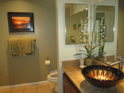 Second bathroom with beautiful vessel sink and new granite counters.