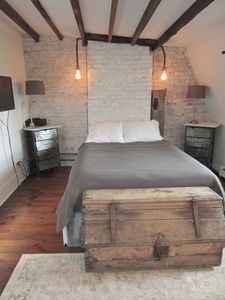 Master BR with exposed brick & beams