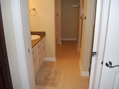 master bath- tub on left -shower on right past the sinks- closet area at end