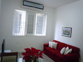 Ipanema apartment photo - 24.000 Btus split air conditioner in living room + sofa seating 3 people