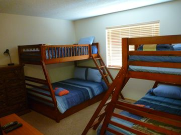 Bunk room with 2 sets of full on bottom, twin on top bunks
