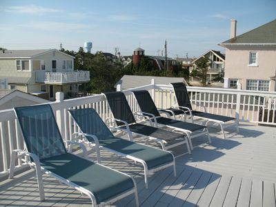 Lounge chairs on top deck with ocean views