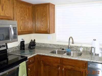 Granite countertops in the Bathrooms and Kitchen