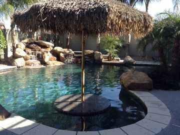 Surprise house rental - Backyard resort pool and spa with table and seating for entertaining.