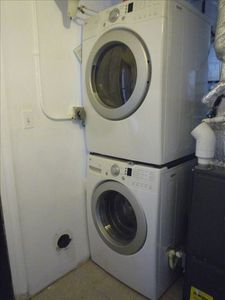 Washer and dryer with access from basement apartment or exterior door