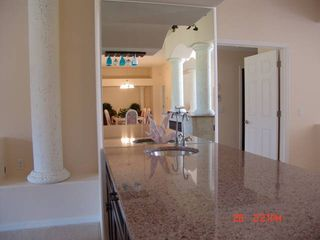 Crystal River house photo - Long wet bar with cooler at end. Mirror reflects D. R. & the double Fireplaces
